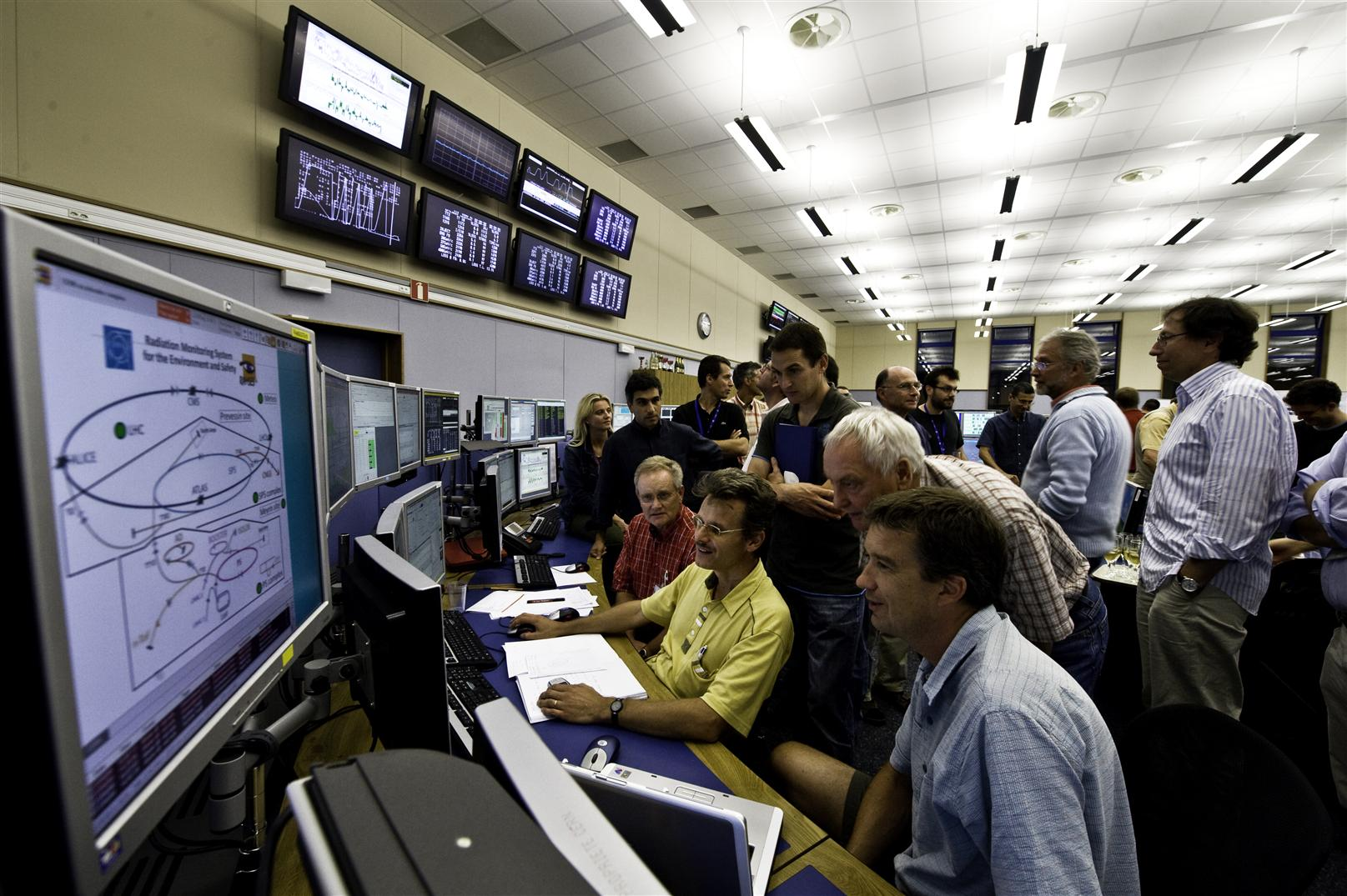 In a 2008 test of the LHC beam synchronization systems, accelerator scientists watch as the first proton bunch made its way from the SPS to the LHC. This is just one of many critical steps toward colliding high-energy protons. (Image courtesy CERN.)