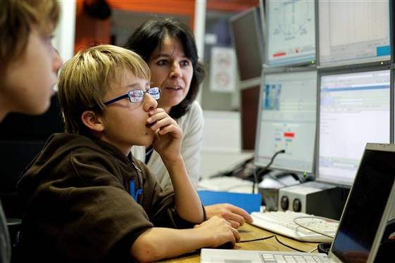Young people in a CERN control room