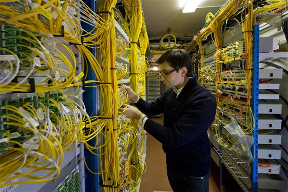 An engineer working with optical fibres