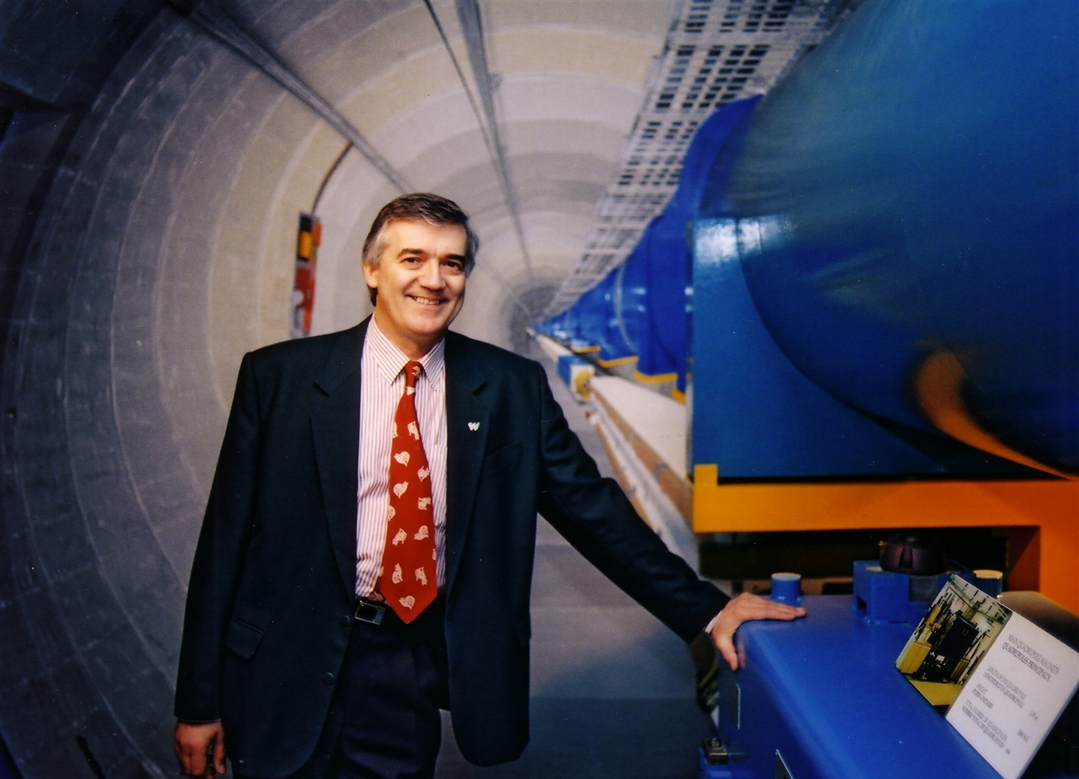 Robert Cailliau, Web pioneer, in front of the LHC exhibit at CERN's Microcosm museum in 2004