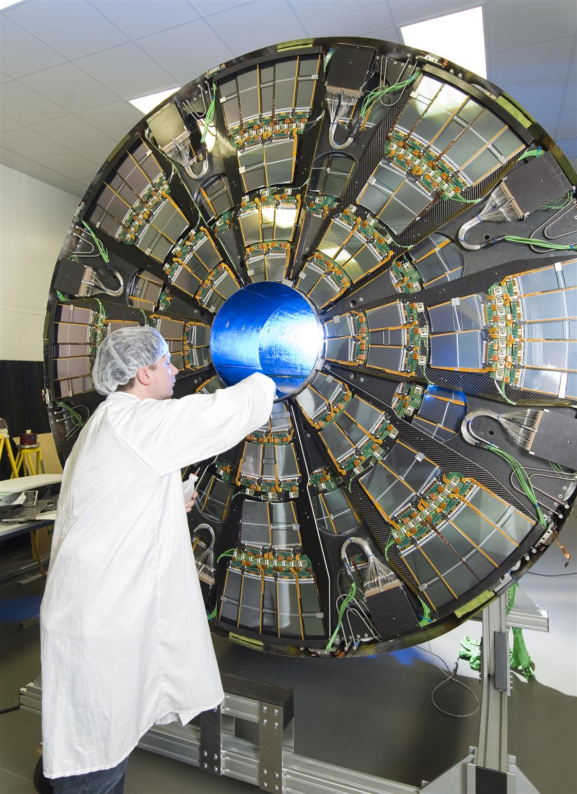 One end-cap of the CMS tracker is opened during installation work