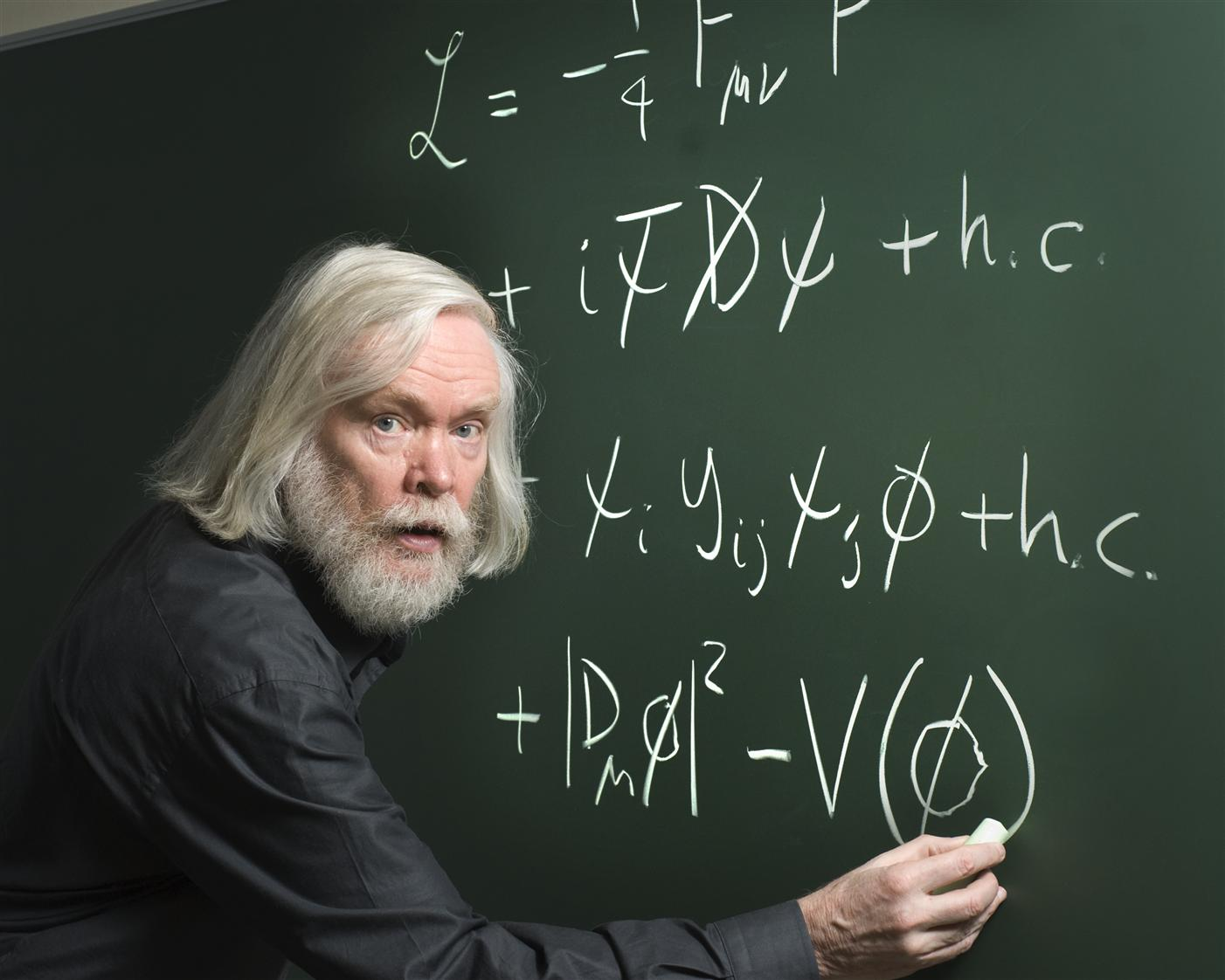 John Ellis, CERN theorist, working on the blackboard