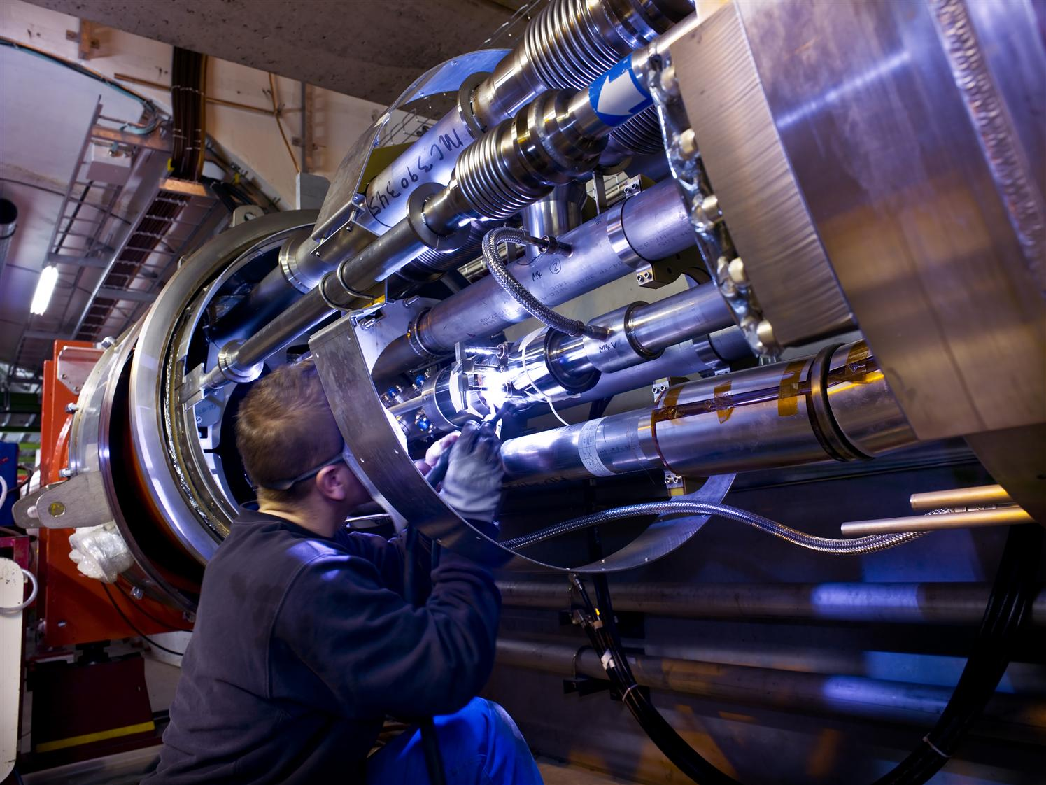 Welding of interconnections of LHC magnets - sector 2-1 close from the ALICE experiment.