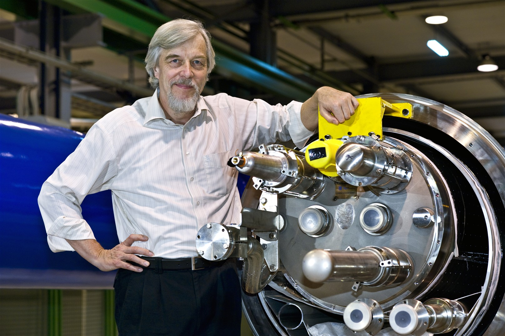 Prof. Rolf-Dieter Heuer with a LHC magnet.  September 2008.