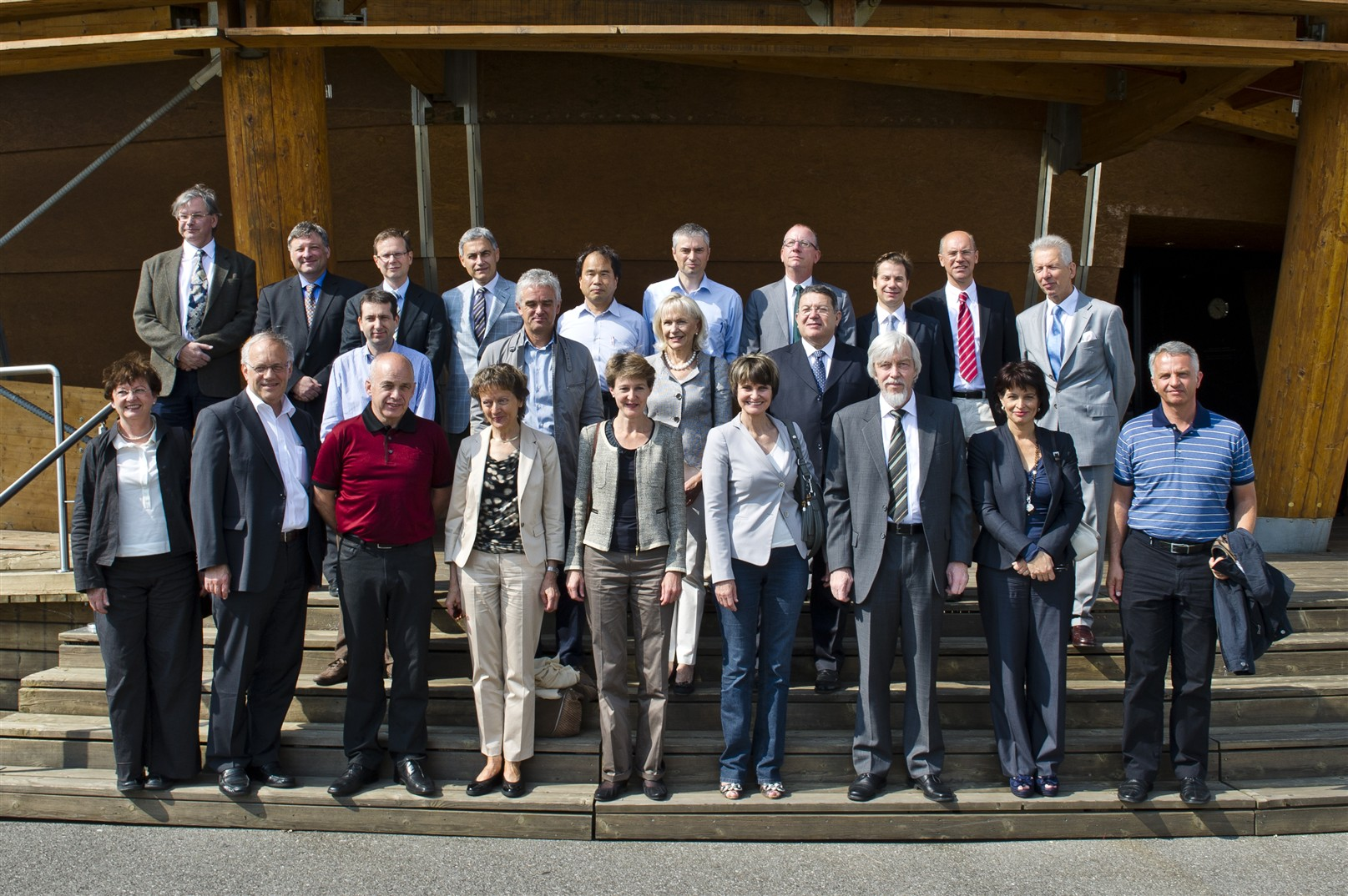 7 July 2011 - Members of the Swiss Federal Council (front row) in front of the Globe of Science and Innovation.