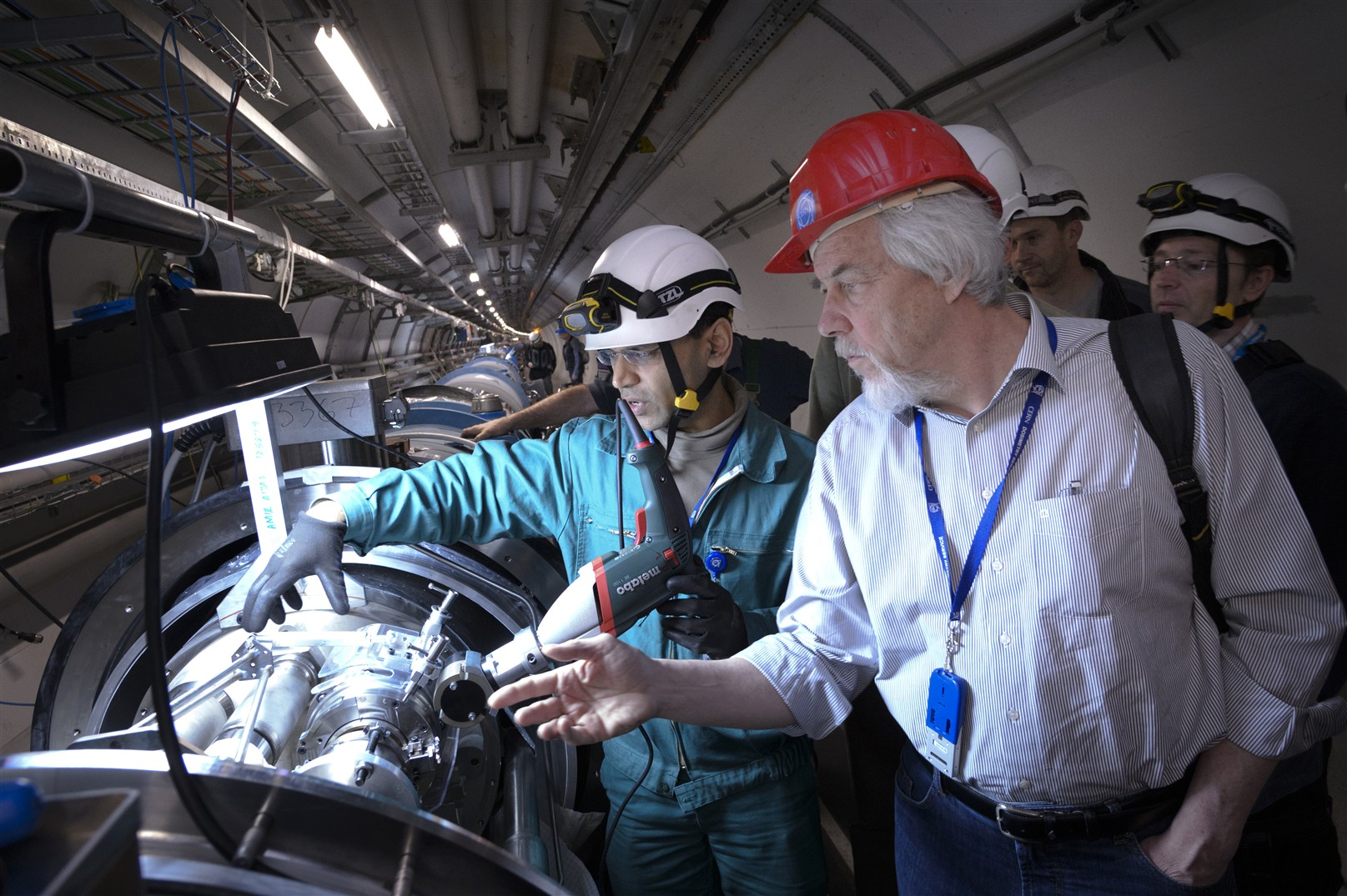 First opening of interconnection in the tunnel LHC during shutdown LS1 in presence of Prof. Rolf Heuer CERN director General.